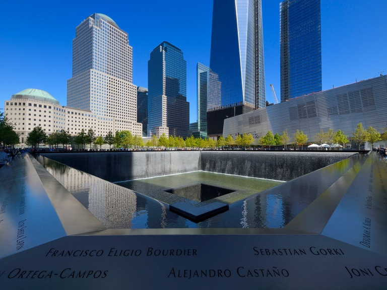 United States, New York, Manhattan, 9/11 Memorial designed by Israeli architect Michael Arad involving a forest of trees around two bodies of water with two large Square holes in their center at the exact spot where the formers towers stood